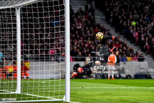 Goalkeeper Jan Oblak of Atletico de Madrid saves the ball during the La Liga 201718 match between Atletico de Madrid and Real Madrid at Wanda...