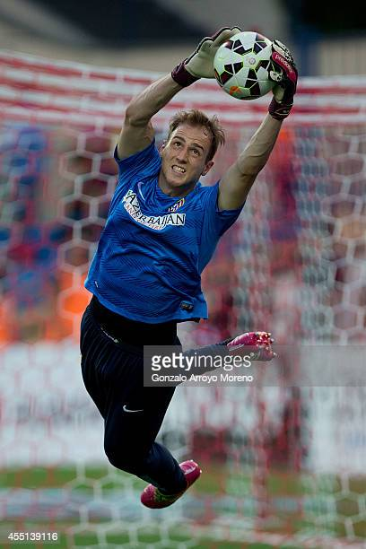 Goalkeeper Jan Oblak of Atletico de Madrid stops the ball during his warming up prior to start the La Liga match between Club Atletico de Madrid and...