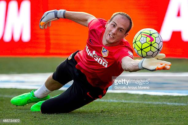 Goalkeeper Jan Oblak of Atletico de Madrid stops the ball during his warming up before the La Liga match between Club Atletico de Madrid and UD Las...