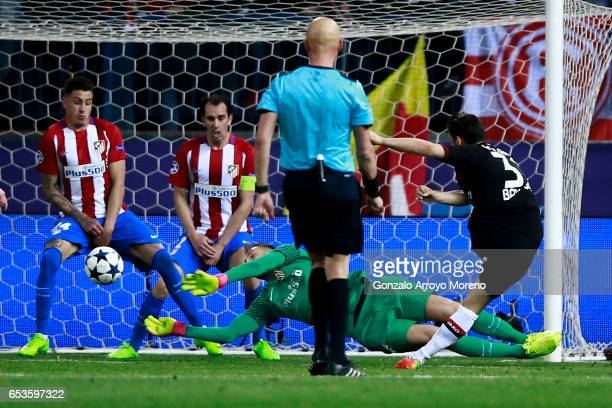 Goalkeeper Jan Oblak of Atletico de Madrid stops the ball striked by Kevin Volland of Bayer Leverkusen during the UEFA Champions League Round of 16...