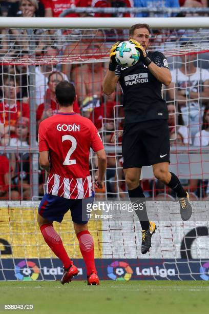 Goalkeeper Jan Oblak of Atletico Madrid controls the ball during the first Audi Cup football match between Atletico Madrid and SSC Napoli in the...