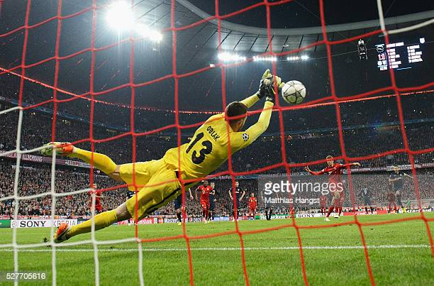 Goalkeeper Jan Oblak of Atletico Madrid saves a penalty kick from Thomas Mueller of Bayern Munich during UEFA Champions League semi final second leg...