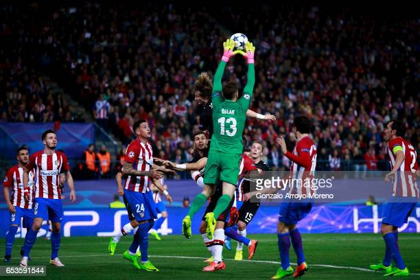 Goalkeeper Jan Oblak stops the ball during the UEFA Champions League Round of 16 second leg match between Club Atletico de Madrid and Bayer...