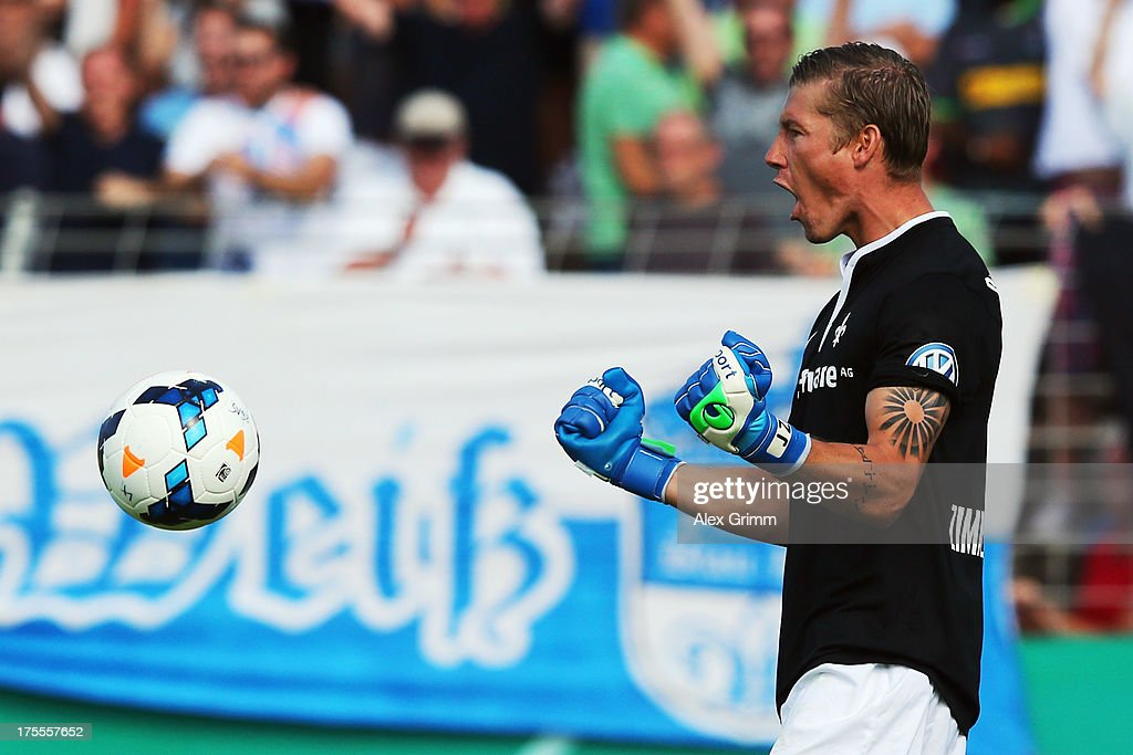 Goalkeeper Jan Zimmermann of Darmstadt celebrates after Branimir Hrgota of Moenchengladbach missed the final penalty during the penalty shoot-out of the DFB Cup first round match between Darmstadt 98 and Borussia Moenchengladbach at Boellenfalltorstadion on August 4, 2013 in Darmstadt, Germany.