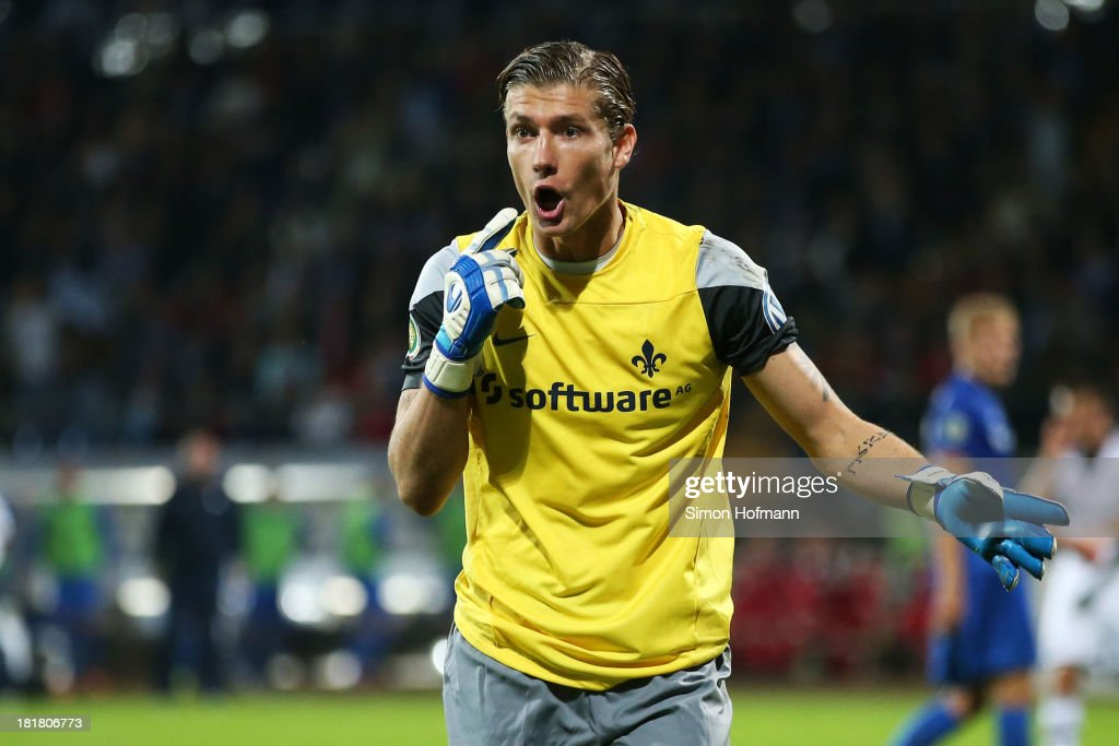 Goalkeeper Jan Zimmermann of Darmstadt reacts during the DFB Cup second round match between Darmstadt 98 and Schalke 04 at Stadion am Boellenfalltor on September 25, 2013 in Darmstadt, Germany.
