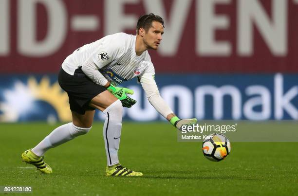 Goalkeeper Janis Blaswich of Rostock throws the ball during the third league match between FC Hansa Rostock and VfL Osnabrueck at Ostseestadion on...