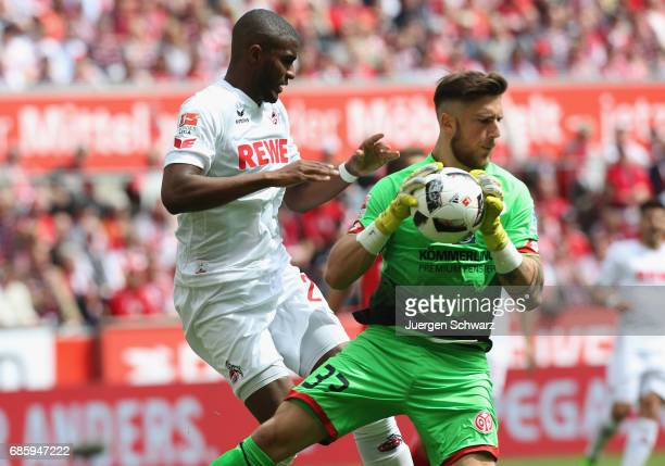 Goalkeeper Jannik Huth grabs the ball near Anthony Modeste of Cologne during the Bundesliga match between 1 FC Koeln and 1 FSV Mainz 05 at...