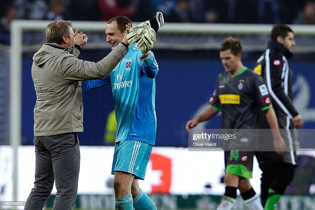 Goalkeeper <a gi-track='captionPersonalityLinkClicked' href=/galleries/search?phrase=Jaroslav+Drobny&family=editorial&specificpeople=1569062 ng-click='$event.stopPropagation()'>Jaroslav Drobny</a> (C) and head coach <a gi-track='captionPersonalityLinkClicked' href=/galleries/search?phrase=Thorsten+Fink&family=editorial&specificpeople=2381735 ng-click='$event.stopPropagation()'>Thorsten Fink</a> (L) of Hamburg celebrate after the Bundesliga match between Hamburger SV and Borussia Moenchengladbach at Imtech Arena on February 16, 2013 in Hamburg, Germany.