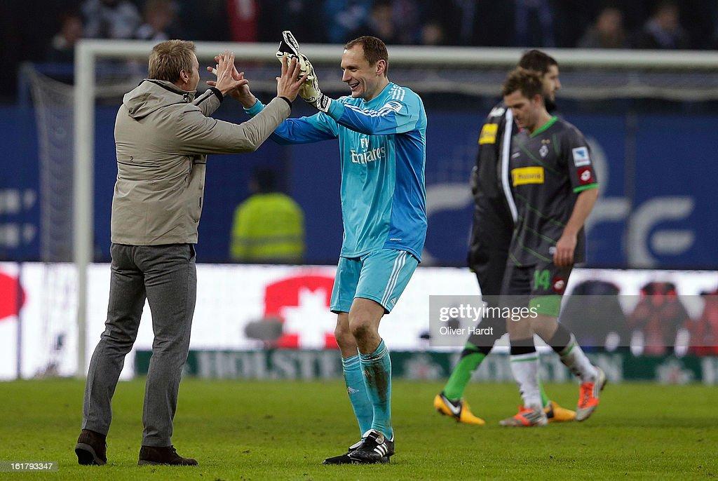 Goalkeeper Jaroslav Drobny (C) and head coach Thorsten Fink (L) of Hamburg celebrate after the Bundesliga match between Hamburger SV and Borussia Moenchengladbach at Imtech Arena on February 16, 2013 in Hamburg, Germany.