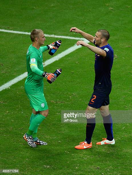 Goalkeeper Jasper Cillessen and Ron Vlaar of the Netherlands celebrate after defeating Spain 51 during the 2014 FIFA World Cup Brazil Group B match...