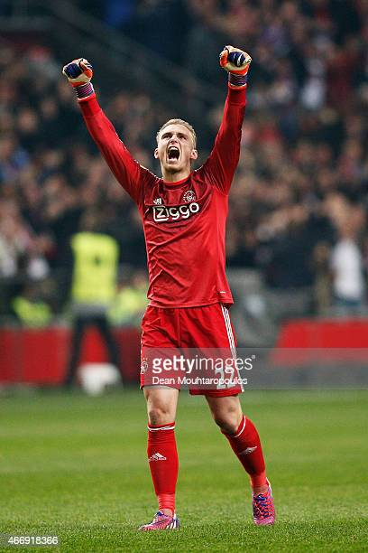 Goalkeeper Jasper Cillessen of Ajax celebrates after teammate Riechedly Bazoer of Ajax scores a goal to level the scores at 11 on aggregate during...
