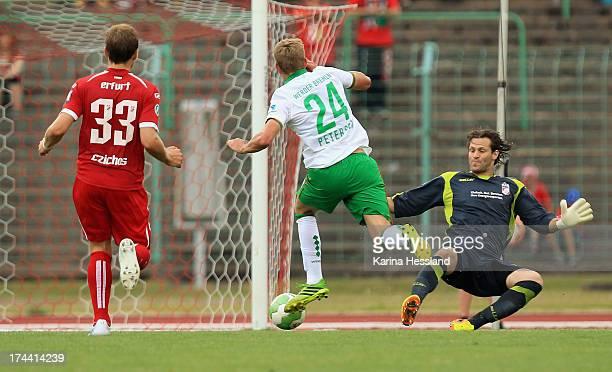 Goalkeeper Jean Francois Kornetzky of Erfurt reacts as Nils Petersen of Bremen shoots the opening goal during the friendly match between RW Erfurt...