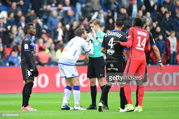Goalkeeper JeanLouis Leca of Bastia complains that he was attending to an injured PSG player in the box when Marco Verratti of PSG scored during the...