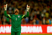 Goalkeeper Jefferson of Brazil celebrates after saving Lionel Messi's penalty kick during a match between Argentina and Brazil as part of 2014...