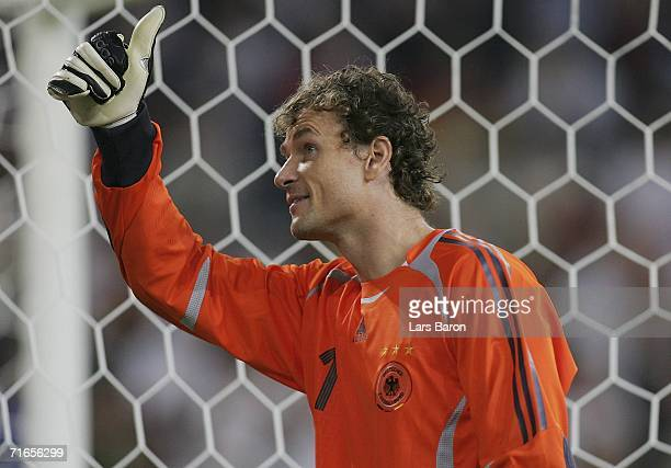 Goalkeeper Jens Lehmann of Germany celebrates winning the friendly match between Germany and Sweden at the Arena Auf Schalke on August 16 2006 in...