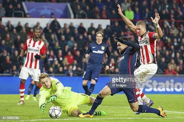 goalkeeper Jeroen Zoet of PSV Angel Correa of Club Atletico de Madrid Jeffrey Bruma of PSV during the UEFA Champions League Round of 16 First leg...