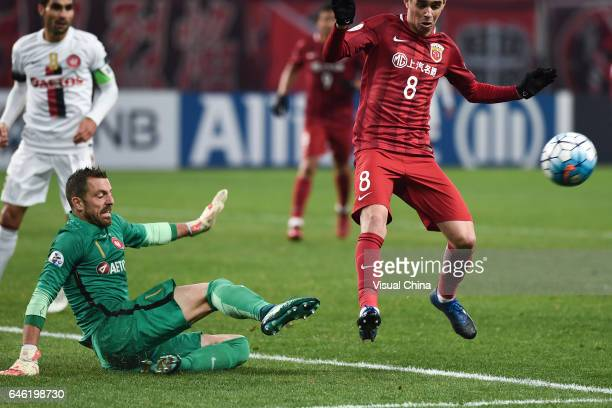 Goalkeeper Jerrad Tyson of Western Sydney Wanderers saves the ball against Oscar of Shanghai SIPG during the AFC Champions League 2017 Group F match...