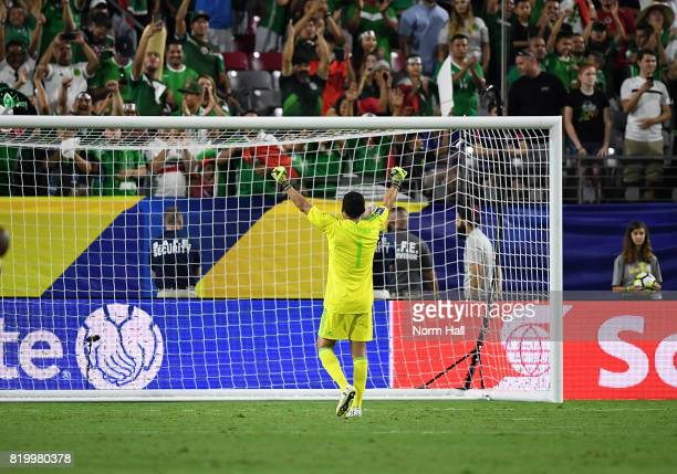 Goalkeeper Jesus Corona of Mexico gestures to the fans after beating Honduras 10 in a quarterfinal match during the CONCACAF Gold Cup at University...