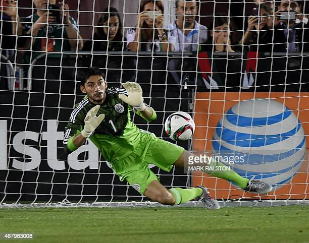 Goalkeeper Jesus Corona of Mexico saves an Ecuador penalty kick during a friendly football match at the LA Memorial Coliseum in Los Angeles...