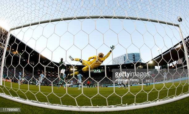 Goalkeeper Jimmy Neilsen of Sporting Kansas City dives to stop a goal score by Darlington Nagbe of the Portland Timbers on July 2 2011 at JeldWen...
