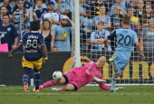 Goalkeeper Jimmy Nielsen of Sporting Kansas City deflects a shot on goal from player Peguy Luyindula of the New York Red Bulls during the second half...