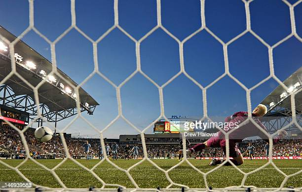 Goalkeeper Jimmy Nielsen of the Sporting Kansas City dives the wrong way on a penalty kick by Lionard Pajoy of the Philadelphia Union at PPL Park on...