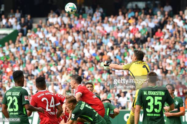 Goalkeeper Jiri Pavlenka of Bremen saves a shot on the goal during the Bundesliga match between SV Werder Bremen and FC Bayern Muenchen at...