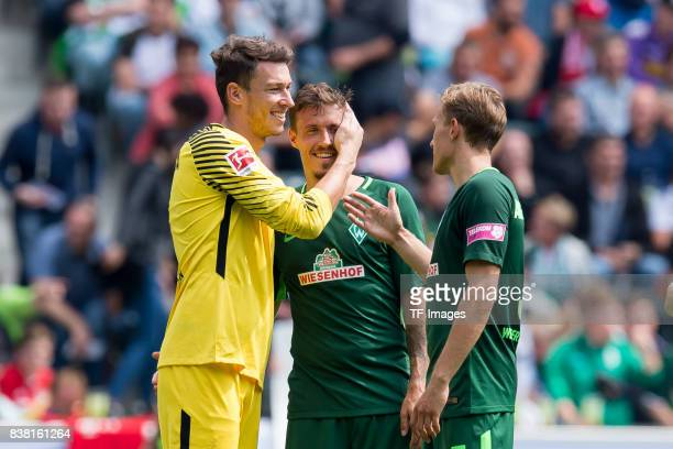 Goalkeeper Jiri Pavlenka of Bremen shakes hands with Max Kruse of Bremen during the Telekom Cup 2017 match between Borussia Moenchengladbach and...