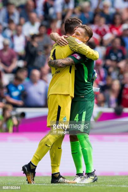 Goalkeeper Jiri Pavlenka of Bremen shakes hands with Robert Bauer of Bremen during the Telekom Cup 2017 match between Borussia Moenchengladbach and...