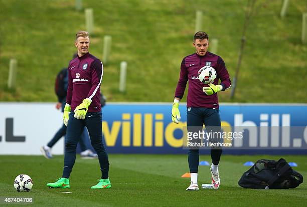 Goalkeeper Joe Hart of England looks to Jack Butland of England during an England training session at St Georges Park on March 24 2015 in...