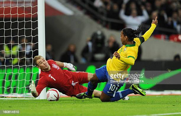 Goalkeeper Joe Hart of England saves the penalty of Ronaldinho of Brazil during the International Friendly match between England and Brazil at...