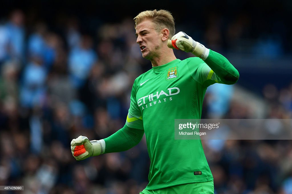 Goalkeeper Joe Hart of Manchester City celebrates after his team go 4-1 ahead during the Barclays Premier League match between Manchester City and Tottenham Hotspur at Etihad Stadium on October 18, 2014 in Manchester, England.
