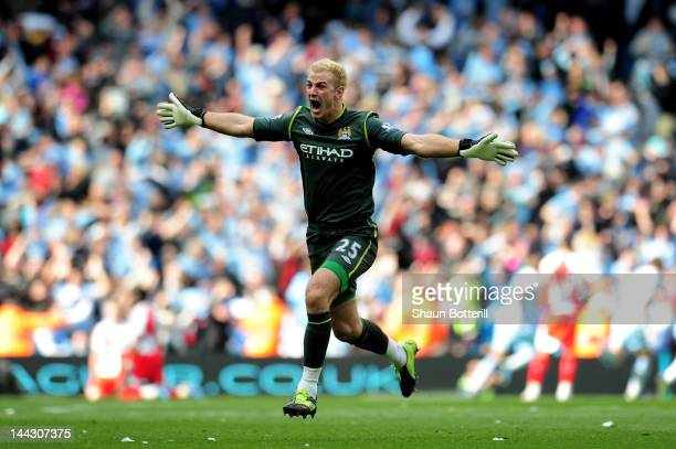 Goalkeeper Joe Hart of Manchester City celebrates winning the title as the final whistle blows during the Barclays Premier League match between...