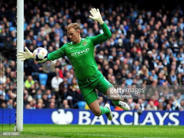 Goalkeeper Joe Hart of Manchester City makes a save during the Barclays Premier League match between Manchester City and Southampton at Etihad...