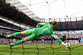 Goalkeeper Joe Hart of Manchester City saves the penalty attempt from Roberto Soldado of Spurs during the Barclays Premier League match between...
