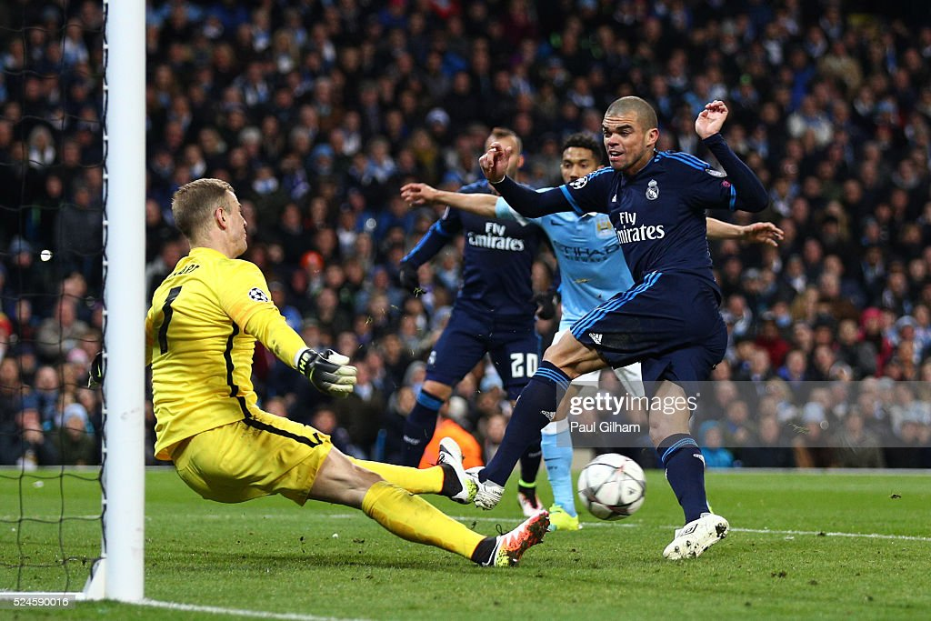 Goalkeeper Joe Hart of Manchester City saves the point blank shot from Pepe of Real Madrid CF during the UEFA Champions League Semi Final first leg match between Manchester City FC and Real Madrid at the Etihad Stadium on April 26, 2016 in Manchester, United Kingdom.