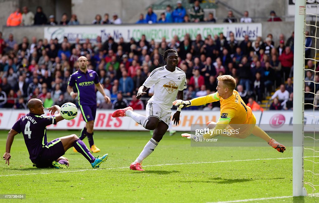 Goalkeeper Joe Hart of Manchester City saves the shot on goal from Bafetibis Gomis of Swansea City during the Barclays Premier League match between Swansea and Manchester City at the Liberty Stadium on May 17, 2015 in Swansea, Wales.