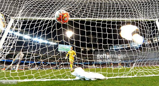 Goalkeeper Joe Hart of Manchester City walks to the back of the net after Real Madrid scored a goal during the International Champions Cup football...