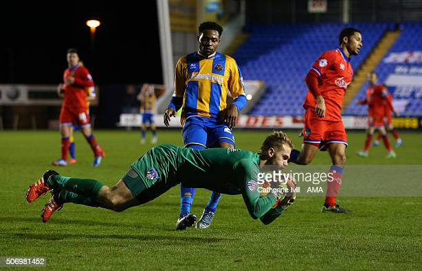 Goalkeeper Joel Coleman of Oldham Athletic comes out to make a save as JeanLouis Akpa Akpro of Shrewsbury Town presses during the Sky Bet League One...