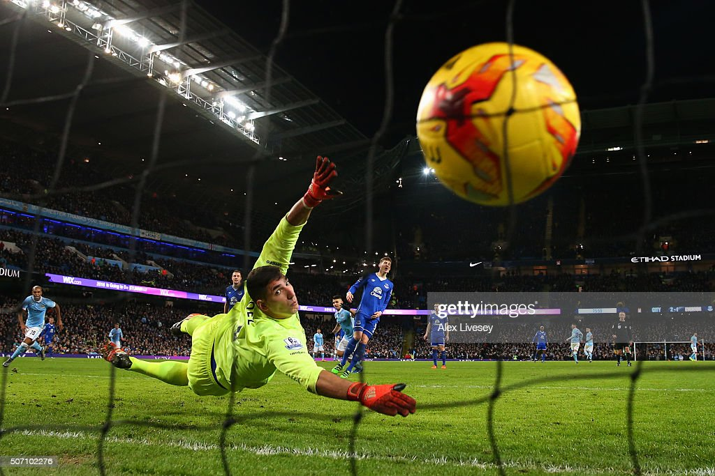 Goalkeeper Joel Robles of Everton dives in vain as Sergio Aguero (C) of Manchester City scores the winning goal to take his team to the final during the Capital One Cup Semi Final, second leg match between Manchester City and Everton at the Etihad Stadium on January 27, 2016 in Manchester, England.