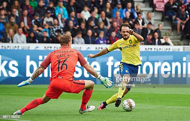 Goalkeeper Johan Dahlin of FC Midtjylland and Marco Urena of Brondby IF compete for the ball during the Danish Alka Superliga match between FC...