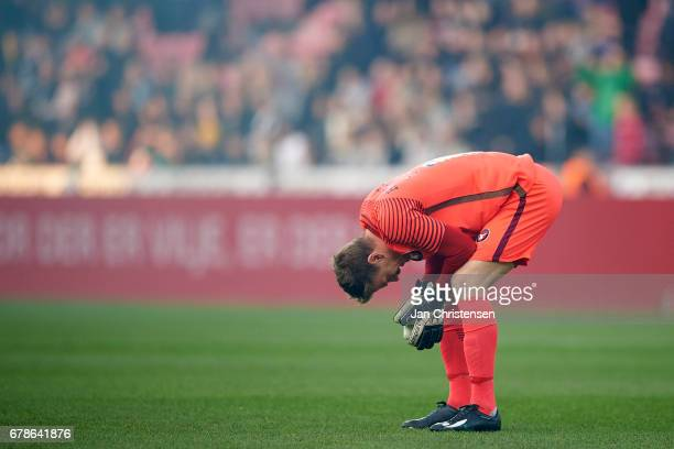 Goalkeeper Johan Dahlin of FC Midtjylland looks dejected after the Danish Cup DBU Pokalen semifinal match between FC Midtjylland and Brondby IF at...