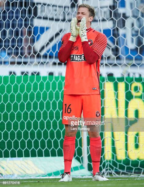 Goalkeeper Johan Dahlin of FC Midtjylland shouts during the Danish Alka Superliga Europa League Playoff match between FC Midtjylland and Randers FC...