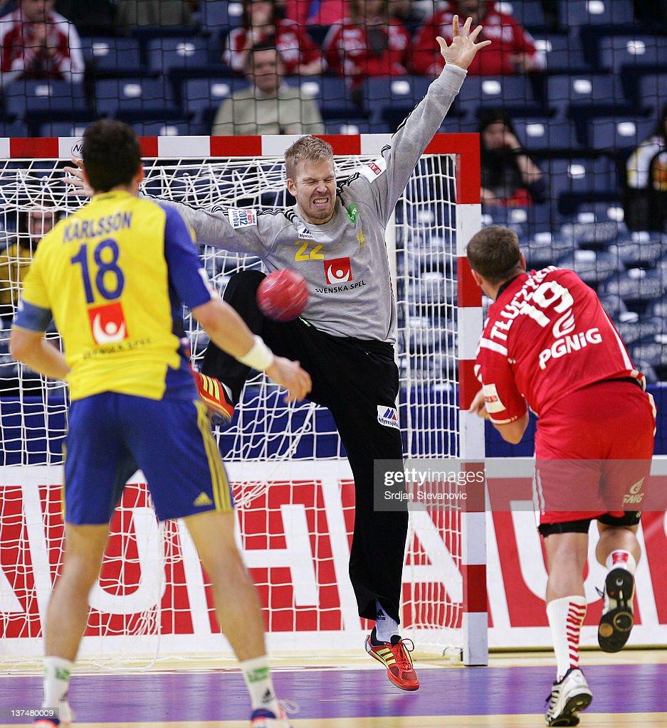 Goalkeeper Johan Sjostrand (C) of Sweden blocks Tomasz Tluczynski (R) of Polandduring the Men's European Handball Championship 2012 main group 1 match between Poland and Sweden, at Belgrade Arena Hall on January 21, 2011 in Belgrade, Serbia.
