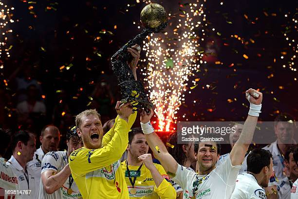 Goalkeeper Johannes Bitter and Matthias Flohr of Hamburg celebrate winning the championship with the trophy after the EHF Final Four final match...