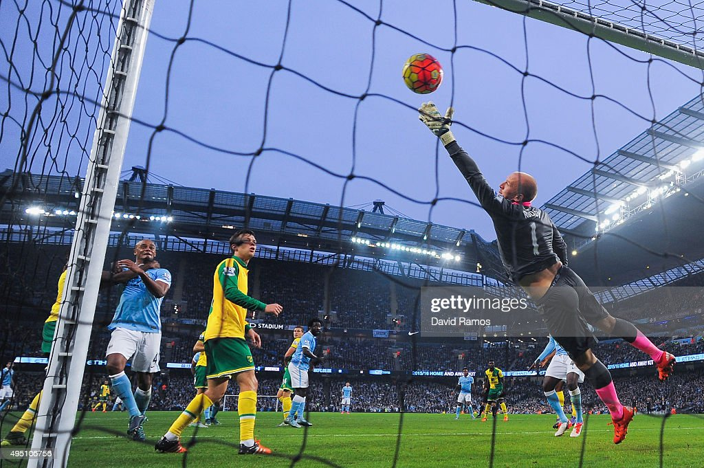 Goalkeeper John Ruddy of Norwich City fails to stop Nicolas Otamendi of Manchester City (not pictured) from scoring their first goal during the Barclays Premier League match between Manchester City and Norwich City at Etihad Stadium on October 31, 2015 in Manchester, England.