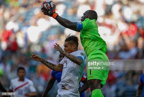 Goalkeeper Johnny Placide of Haiti defends against Paolo Guerrero of Peru during the Copa America Centenario Group B match at CenturyLink Field on...