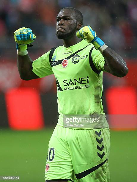 Goalkeeper Johny Placide of Stade de Reims celebrates a goal for Reims during the French Ligue 1 match between Stade de Reims and Paris Saint Germain...