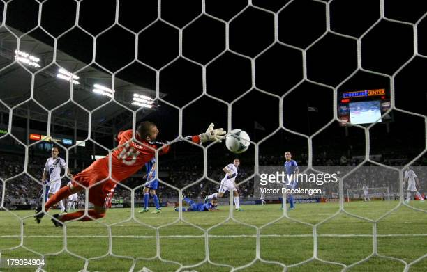 Goalkeeper Jon Busch of San Jose Earthquakes can't make the save on a volley by Robbie Keane of Los Angeles Galaxy for a goal in the second half...