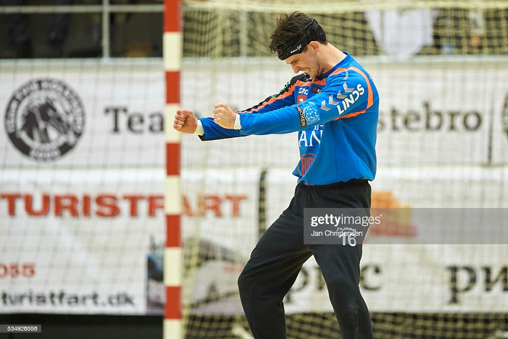 Goalkeeper Jonas Hansen of Team Tvis Holstebro celebrate after save during the Danish Boxer Herreligaen second final match between Team Tvis Holstebro and BSV Bjerringbro Silkeborg in Grakjar Arena on May 28, 2016 in Holstebro, Denmark.
